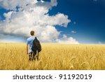 man in yellow wheat meadow.... | Shutterstock . vector #91192019