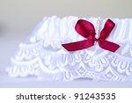 a white wedding garter with a...   Shutterstock . vector #91243535