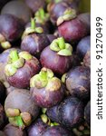 Mangosteen fruits at Bangkok morning market. - stock photo