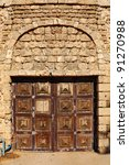 Door of the ancient building made of the Jerusalem stone (Tel Aviv, Israel) - stock photo