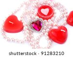 Heart shape red candles, stone and  necklace  on white background. - stock photo