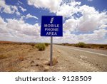 Sign in the Australian desert telling you that you can use the mobile phone in this area - stock photo