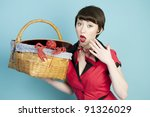 Pinup model with red lobster with surprised expression - stock photo