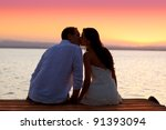Couple Kissing At Sunset...