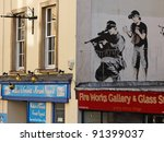 Small photo of BRISTOL, ENGLAND - FEBRUARY 26: Police sniper by Banksy in Upper Maudlin Street in Bristol, England on February 26, 2011