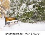 Bench In Park Under Snow