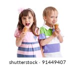 happy children twins girl and boy with ice cream in studio isolated - stock photo