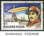 HUNGARY - CIRCA 1977: A stamp printed in Hungary, shows Alberto Santos-Dumont and airship, flying around Eiffel Tower, circa 1977 - stock photo