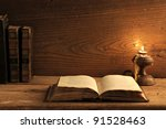 Old Book On A Wooden Table By...