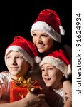 family of a three in santa hats | Shutterstock . vector #91624934
