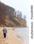 Nordic walking woman - autumn baltic sea cliff in Orlowo, Gdynia Poland - stock photo