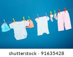 Stock photo baby laundry hanging on the rope 91635428