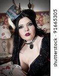 Beautiful sensual steampunk woman wearing mini top hat - stock photo