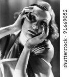 closeup of distraught woman | Shutterstock . vector #91669052