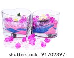 Heart shape vases with colorful stones and sand isolated on white background. - stock photo