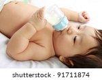 little baby boy drinks milk... | Shutterstock . vector #91711874
