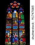 Stained glass window in Votive Church (Votivkirche), Vienna, Austria. - stock photo