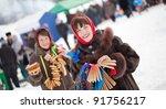 Two happy girls celebrating  Pancake Week at Russia - stock photo