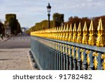 Golden picket fence around the Luxor obelisk at Place de la Concorde in Paris - stock photo