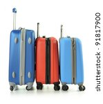 Luggage consisting of three suitcases standing in the raw isolated on white - stock photo