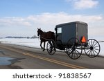 An Amish Carriage Travels In...