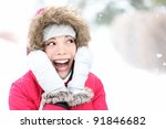 Excited winter woman looking to side smiling happy and joyful holding head. Beautiful mixed race asian caucasian girl playful in the snow. - stock photo