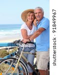 mature couple with bikes by a...   Shutterstock . vector #91849967