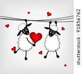 two sheep with red hearts  ...