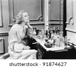 woman sitting on a vanity... | Shutterstock . vector #91874627