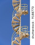 Industrial Steel Spiral Stairs with Safety Railing - stock photo