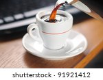 Pouring a cup of hot coffee. Selective focus - stock photo