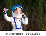 Young Boy In An Astronaut Suit...