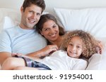 smiling family relaxing on a... | Shutterstock . vector #91954001
