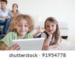 happy children using a tablet... | Shutterstock . vector #91954778