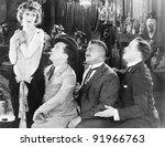 Three men looking longingly at a woman - stock photo