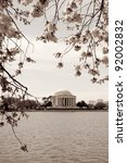 Vintage photograph of Jefferson Memorial framed with cherry blossoms - stock photo