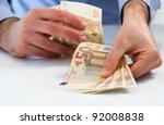 man handling money. | Shutterstock . vector #92008838