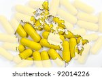 Outline map of Canada with yellow  capsules in background - stock photo