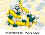 Outline map of Canada with yellow and green and white capsules in background - stock photo