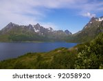 Picturesque scenery on Lofoten Islands with fjord and steep rocky mountains - stock photo