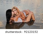 two beautiful girls posing in... | Shutterstock . vector #92123152