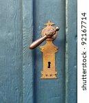 An Old Wood Door With Metal...