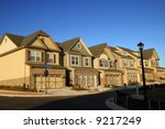 Early Morning Sunrise on New Townhouses for Sale - stock photo