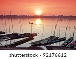 fisherman boat in mekong river... | Shutterstock . vector #92176612