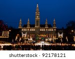 VIENNA - DECEMBER 21: The Vienna City Hall (Rathaus) with Christmas Market on December 21, 2011. In the square in front of the building there is one of the most famous Christmas Market in the world. - stock photo