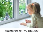 A Sad Little Girl Looks At A...