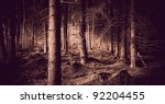 Spooky forest with dry trees in sepia - stock photo
