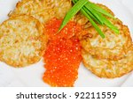 pancakes with red caviar and green onion closeup dish - stock photo
