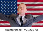 joyful investor spreading arms after good business investment in america, in front of flag - stock photo