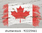 Chalky canadian flag painted with color chalk on grunge wooden texture - stock photo